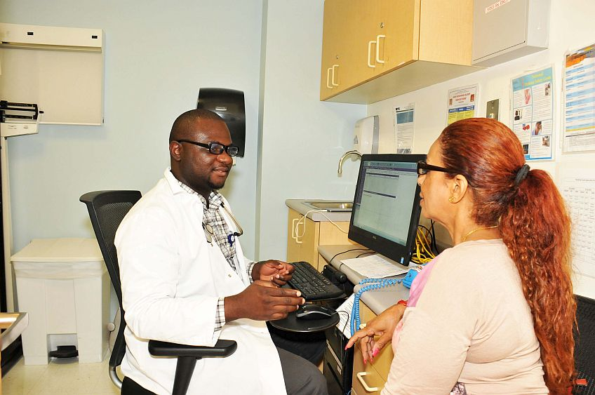 Dr.-Patrick-Odia-Medicine-interacting-with-his-patient-harlem-2